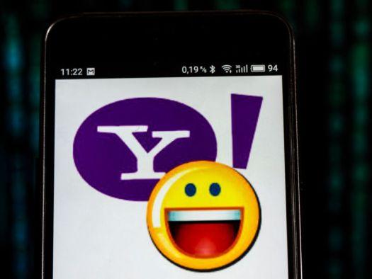 A Yahoo logo on a smartphone.