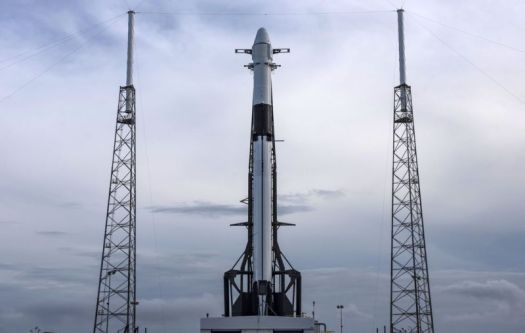 A new Falcon 9 rocket, and a Dragon spacecraft, on the pad Thursday.