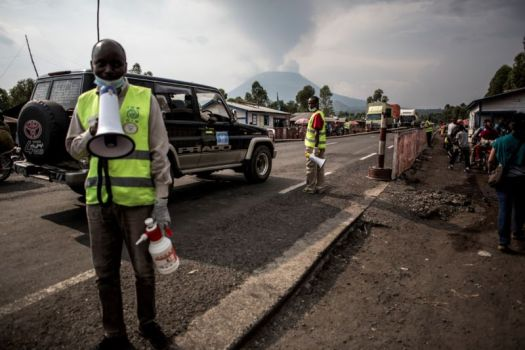 Health workers communicate information about Ebola at an Ebola screening station on the road between Butembo and Goma on July 16, 2019, in Goma, DRC.