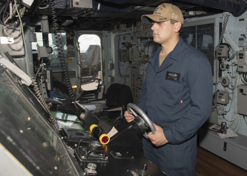 Seaman Timothy North stands watch as the helmsman on the bridge of the Arleigh Burke-class guided-missile destroyer USS Forrest Sherman (DDG 98). Forrest Sherman is participating in a sustainment exercise with the Harry S. Truman Carrier Strike Group, an integrated, comprehensive exercise designed to ensure the strike group is ready to meet all mission sets and carry out sustained combat operations from the sea. (U.S. Navy photo by Mass Communication Specialist 3rd Class Raymond Maddocks/Released)