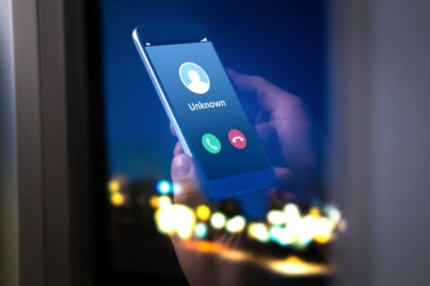 A smartphone with an incoming phone call from an unknown caller.