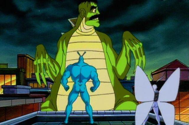 The Tick and Arthur face a gigantic Dinosaur Neil.