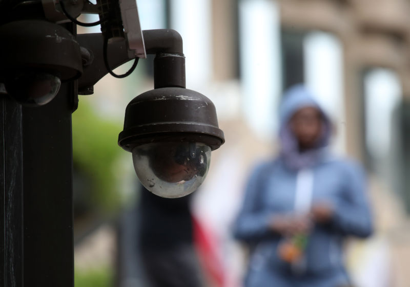 A video surveillance camera hangs from the side of a building on May 14, 2019, in San Francisco, California.