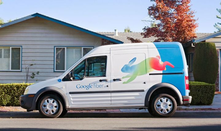 A Google Fiber van parked in front of a house.
