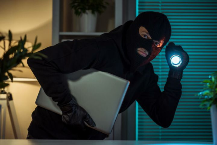 Artist's impression of an insider threat stealing your stuff.