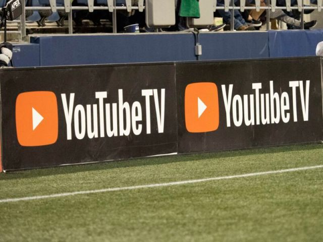 A YouTube TV logo seen on the sidelines of a major league game.