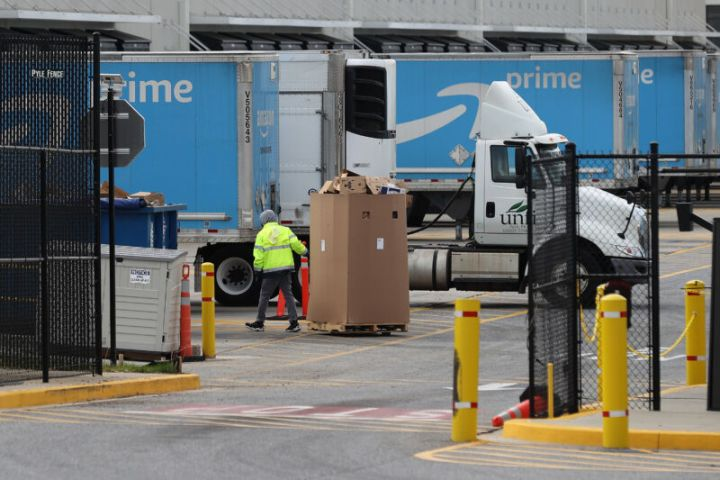 A worker hauling boxes at an Amazon warehouse in Baltimore, Maryland, on April 14.