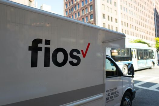 A Verizon FiOS box truck on a street in New York City.