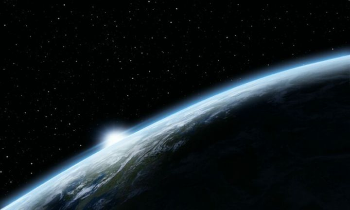 Illustration of a sunrise over planet Earth.