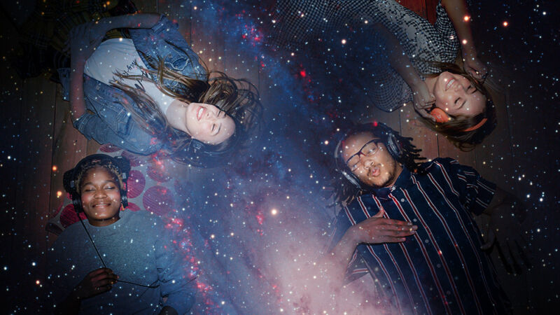 Photos of people relaxing while listening to headphones have been superimposed on the image of a galaxy.