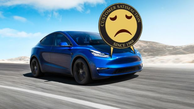 A frowning face has been touched up in a Tesla at full speed along a highway.