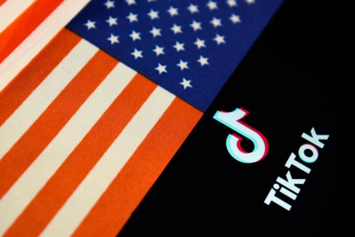 TikTok logo next to inverted US flag.