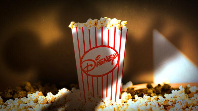 Disney logo adorns a container of movie theater popcorn.
