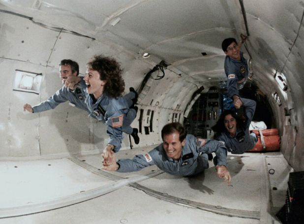 Then Rep. Bill Nelson (D-Fla., at bottom) undergoing zero-gravity training onboard a KC-135 along with other astronaut trainees in 1985. On his right is schoolteacher Christa McAuliffe, who died along with six other crew members in the <em data-recalc-dims=