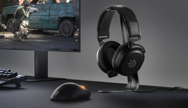 SteelSeries arctis prime on headset stand near monitor