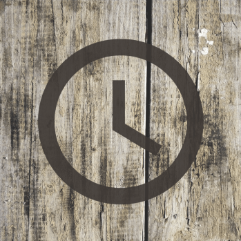 Simple clock on wood plank background, choosing the time you work to accomplish goals, matters