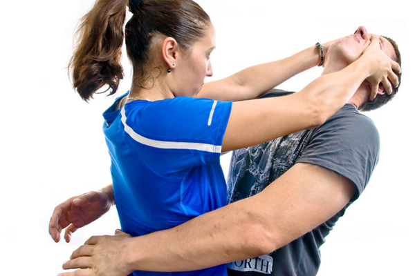 Police, YMCA, Freedom House Team for Women's Self-Defense class
