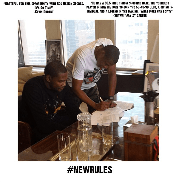 Kevin Durant and Jay-Z sign a contract to enlist Durant among Roc Nation's ranks.