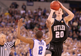 INDIANAPOLIS - APRIL 05:  Gordon Hayward #20 of the Butler Bulldogs shoots a last second shot from half court over Nolan Smith #2 of the Duke Blue Devils that missed during the 2010 NCAA Division I Men's Basketball National Championship game at Lucas Oil Stadium on April 5, 2010 in Indianapolis, Indiana. Duke defeated Butler 61-59 to win the championship. (Photo by Andy Lyons/Getty Images)
