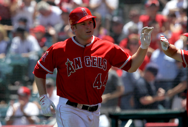 ANAHEIM, CA - JUNE 05:  Mark Trumbo #44 of the Los Angeles Angels of Anaheim is greeted as he returns to the dugout after hitting a home run in the third inning against the New York Yankees on June 5, 2011 at Angel Stadium in Anaheim, California. The Yankees won 5-3.  (Photo by Stephen Dunn/Getty Images)