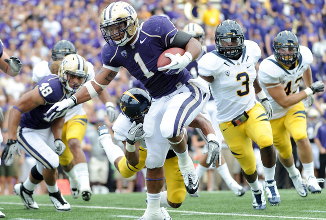 SEATTLE, WA - SEPTEMBER 24:  Chris Polk #1 of the Washington Huskies breaks a tackle to score a touchdown for a 14-7 score against the California Golden Bears during the first quarter at Husky Stadium on September 24, 2011 in Seattle, Washington.  (Photo by Harry How/Getty Images)