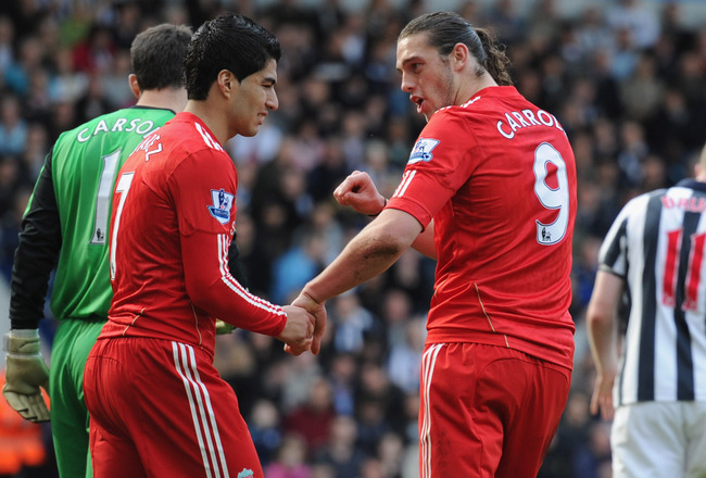 WEST BROMWICH, ENGLAND - APRIL 02: Andy Carroll and Luis Suarez of Liverpool look dejected after a missed chance during the Barclays Premier League match between West Bromwich Albion and Liverpool at The Hawthorns on April 2, 2011 in West Bromwich, England.  (Photo by Michael Regan/Getty Images)
