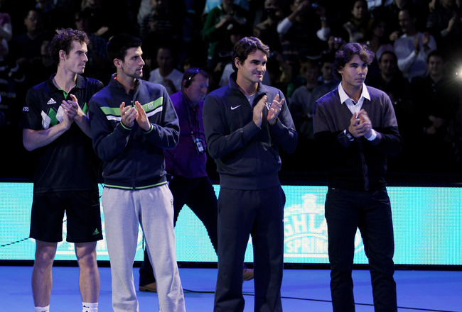 LONDON, ENGLAND - NOVEMBER 21:  (L-R) Andy Murray of Great Britain, Novak Djokovic of Siberia, Roger Federer of Switzerland and Rafael Nadal of Spain attend a ceremony for Carlos Moya's retirement during the Barclays ATP World Tour Finals at O2 Arena on November 21, 2010 in London, England.  (Photo by Clive Brunskill/Getty Images)
