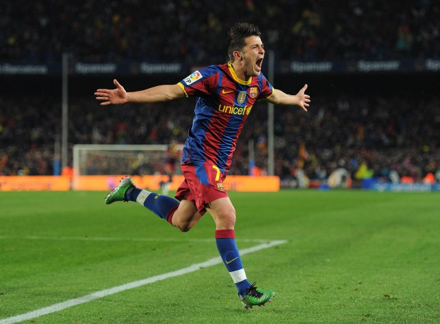 BARCELONA, SPAIN - NOVEMBER 29: David Villa of Barcelona celebrates scoring his sides fourth goal during the la liga match between Barcelona and Real Madrid at the Camp Nou stadium on November 29, 2010 in Barcelona, Spain. (Photo by Jasper Juinen/Getty