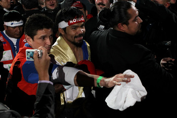 ARLINGTON, TX - NOVEMBER 13:  Manny Pacquiao of the Philippines makes his way to the ring for his fight against Antonio Margarito (black trunks) of Mexico during their WBC World Super Welterweight Title bout at Cowboys Stadium on November 13, 2010 in Arli