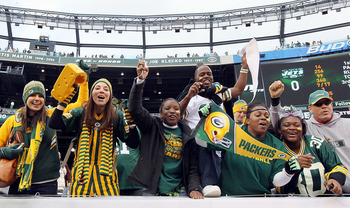EAST RUTHERFORD, NJ - OCTOBER 31:  Fans of the Green Bay Packers celebrate after their team defeated the New York Jets on October 31, 2010 at the New Meadowlands Stadium in East Rutherford, New Jersey. The Packers defeated the Jets 9-0.  (Photo by Jim McI