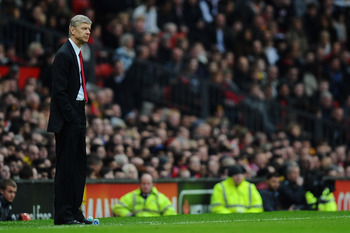 MANCHESTER, ENGLAND - MARCH 12:  Arsenal manager Arsene Wenger looks on during the FA Cup sponsored by E.On Sixth Round match between Manchester United and Arsenal at Old Trafford on March 12, 2011 in Manchester, England.  (Photo by Clive Mason/Getty Imag