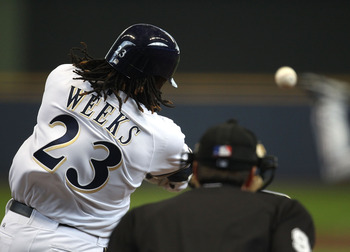 MILWAUKEE, WI - APRIL 04: Rickie Weeks #23 of the Milwaukee Brewers hits a solo home run in the 3rd inning against the Atlanta Braves during the home opener at Miller Park on April 4, 2011 in Milwaukee, Wisconsin. (Photo by Jonathan Daniel/Getty Images)
