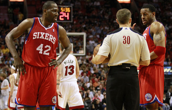 MIAMI, FL - MARCH 25:  Guard Andr Iguodala #9  and Guard Elton Brand #42 of the Philadelphia Sixers argue with the referee against the Miami Heat at American Airlines Arena on March 25, 2011 in Miami, Florida. The Heat defeated the Sixers 111-99. NOTE TO