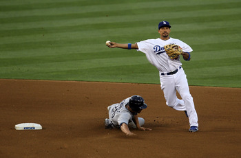 LOS ANGELES, CA - JULY 8:  Shortstop Rafael Furcal #15 of the Los Angeles Dodgers turns a double play after forcing out Will Venable #25 of the San Diego Padres in the third inning on July 8, 2011 at Dodger Stadium in Los Angeles, California.   (Photo by
