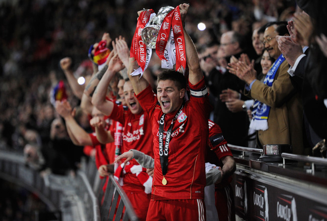 Hi-res-139974570-steven-gerrard-of-liverpool-lifts-the-trophy-in-victory_crop_650x440