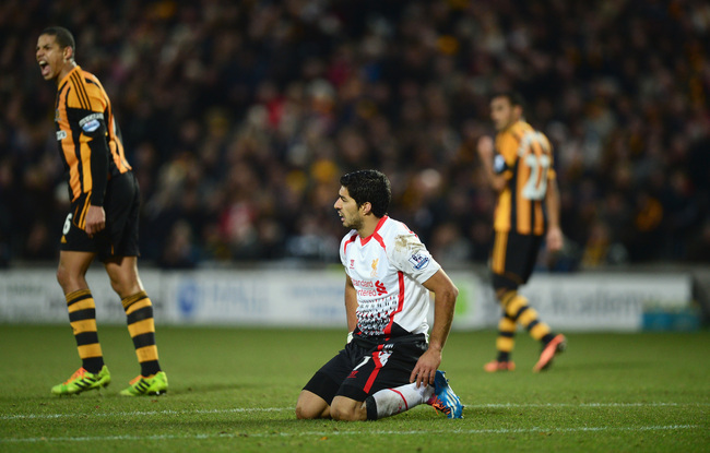 Hi-res-452758835-luis-suarez-of-liverpool-looks-dejected-as-he-falls-to_crop_650
