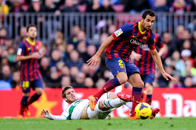Hi-res-460775975-martin-montoya-of-fc-barcelona-duels-for-the-ball-with_crop_650