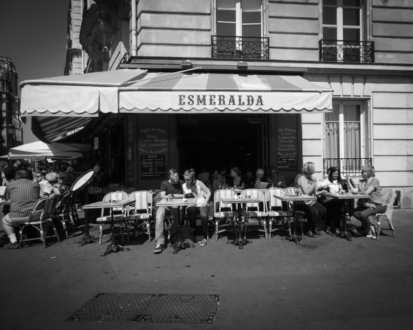 A couple reads the menu at Cafe Esmeralda near Notre Dame in Paris, France.