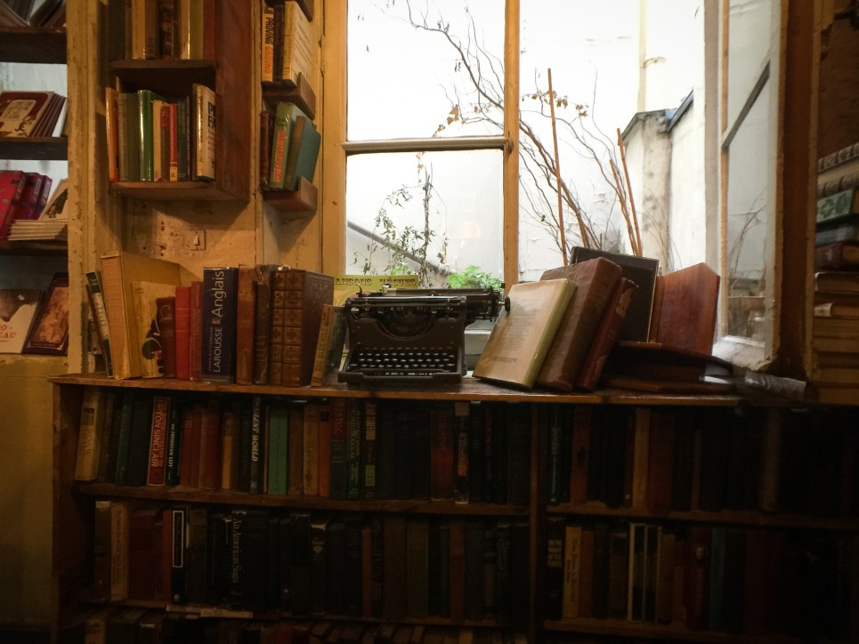 An old typewriter sits on a window sill at Shakespeare & Co. bookstore in Paris, France.