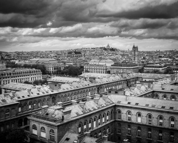 The cityscape of Paris with Sacré-Cœur Basilica in the distance.