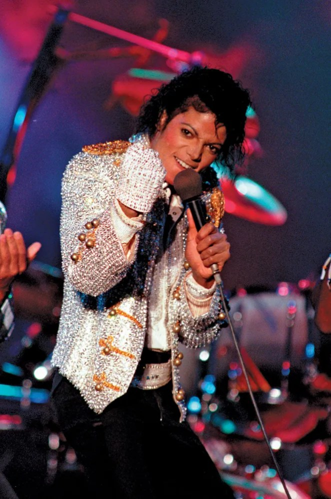 Michael Jackson performs with his brothers at Dodger Stadium in Los Angeles as part of their Victory Tour concert, December 3, 1984.