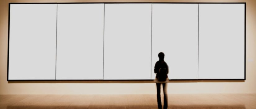 a woman looking at a minimalist art display