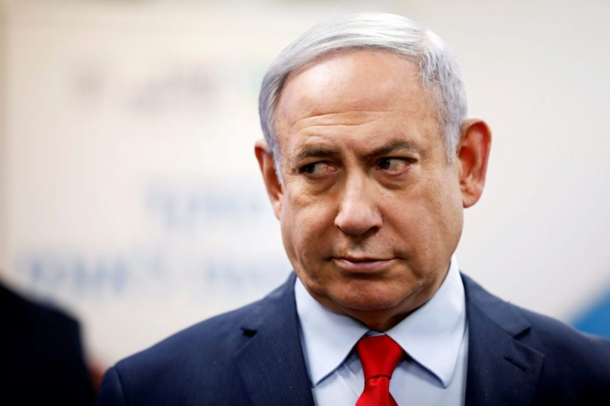 Israeli Prime Minister Benjamin Netanyahu looks on as he delivers a statement during his visit at the Health Ministry national hotline, in Kiryat Malachi, Israel March 1, 2020. REUTERS/Amir Cohen