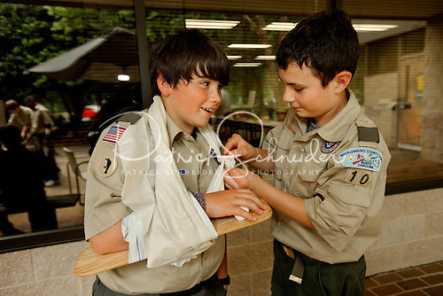 Photo: Scouts practice their First Aid skills as they earn the BSA First Aid merit badge. The First Aid merit badge is required for any Scout working to earn his Eagle badge.