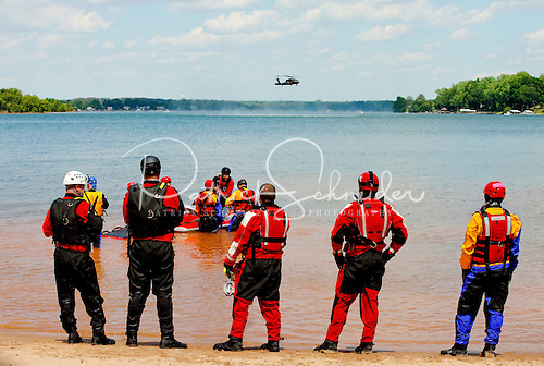 On location photography in Charlotte NC of the North Carolina Helicopter and Aquatic Rescue Team (NCHART) during training exercises.