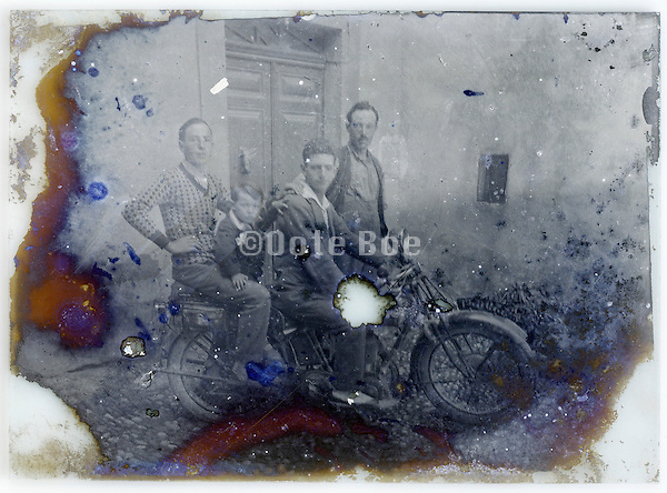 family posing with their motorcycle fading glass plate
