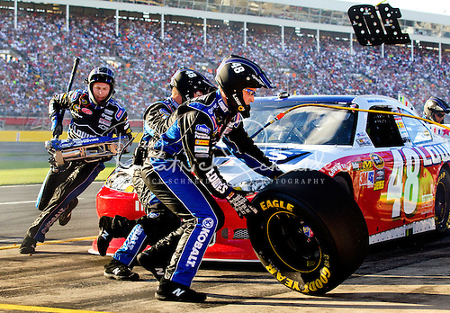 Photo: Lowe's Team 48 pit crew work quickly to get driver Jimmie Johnson back in the race.