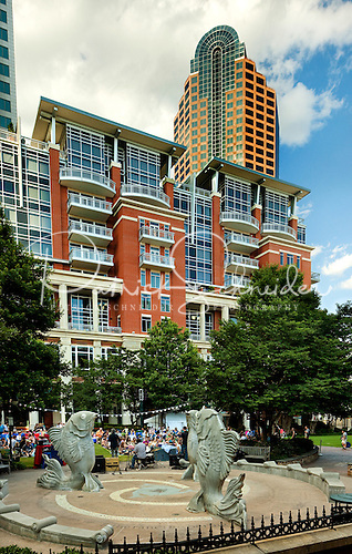 The Ratcliffe Condos flank The Green, a pocket park in uptown Charlotte that is home to many pieces of public art, including The Fish Fountain shown in this photo.