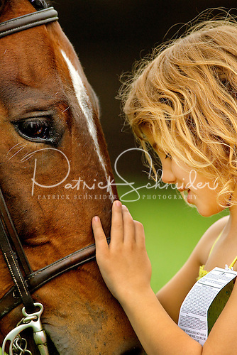 Photo of girl sharing a moment with her horse.