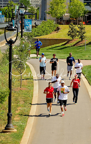Photo: Lunch-time exercisers run through along the greenway at Midtown Park.